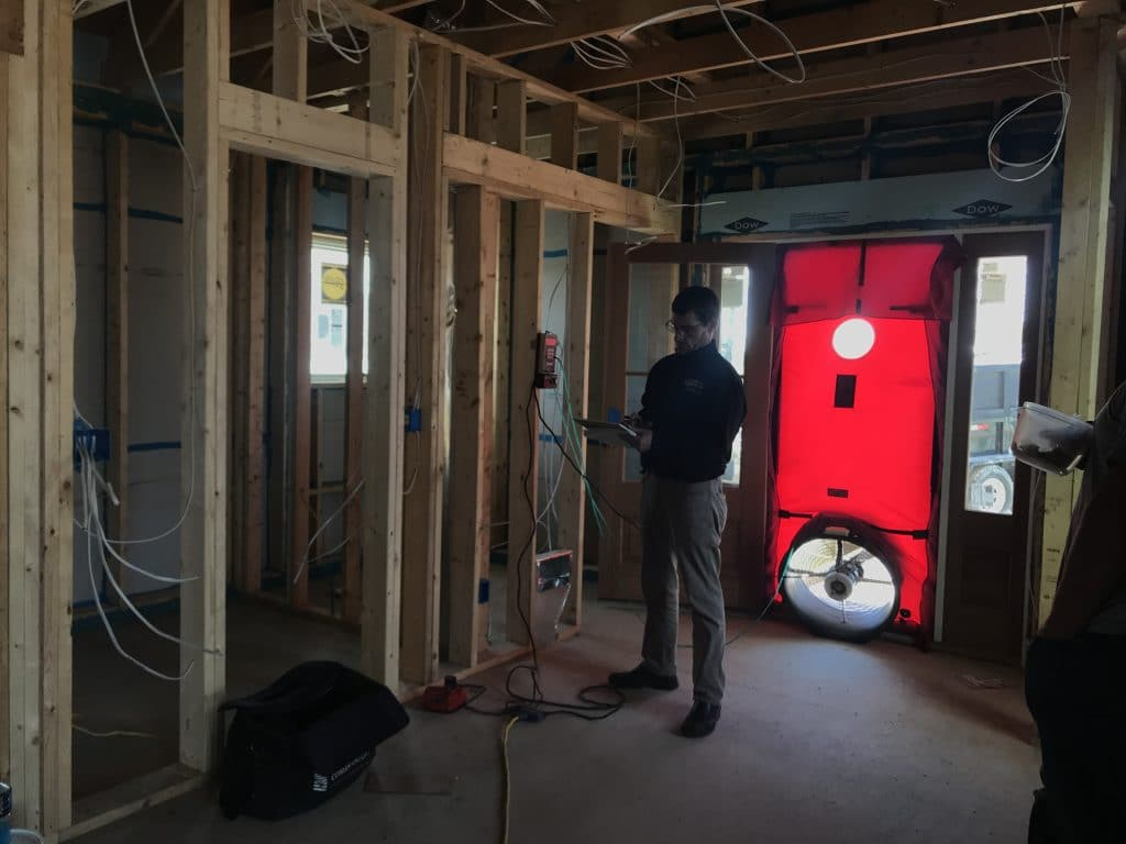 Blower door used to measure air leakage of a building.