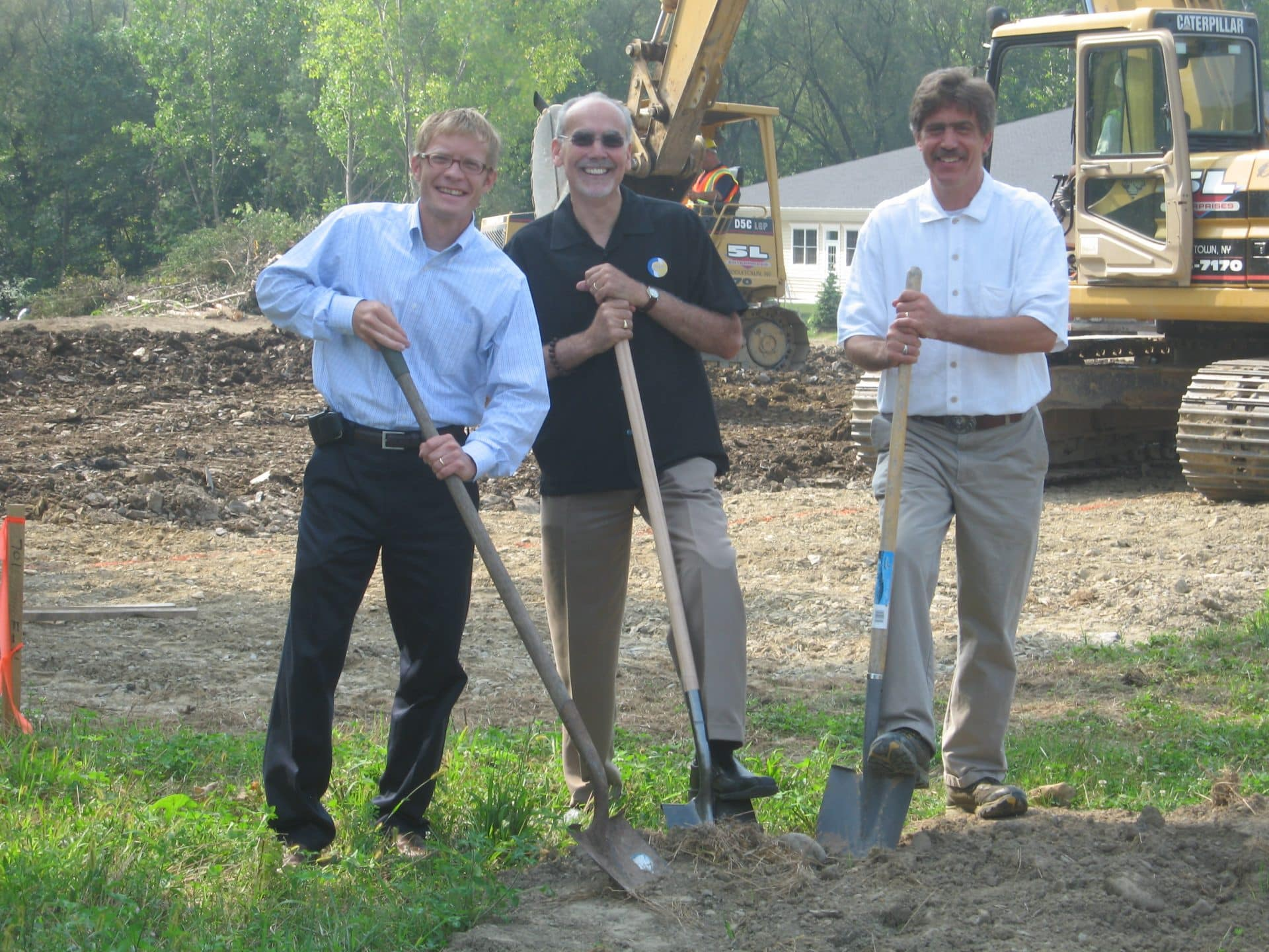 POA breaking ground image with client and architect.